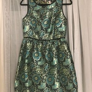 Green and gold A-line dress w/ black trim